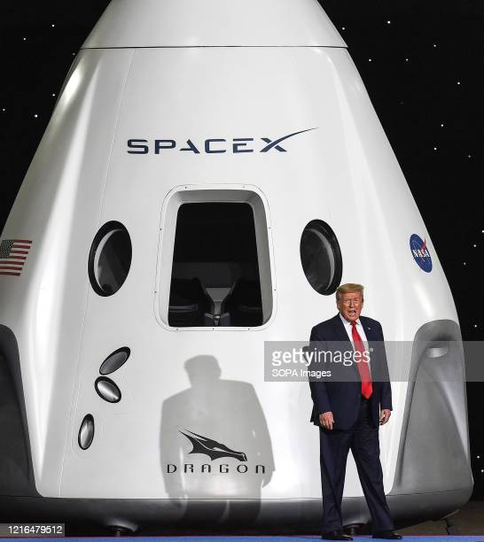 S President Donald Trump takes the stage at NASA's Vehicle Assembly Building to give remarks following the successful launch of a Falcon 9 rocket...