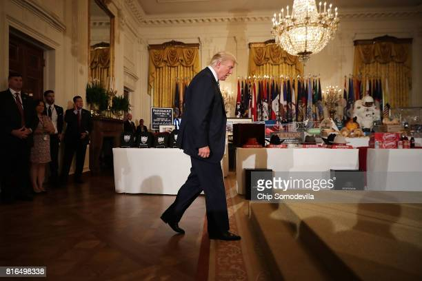 S President Donald Trump takes the stage during a Made in America product showcase in the East Room of the White House July 17 2017 in Washington DC...
