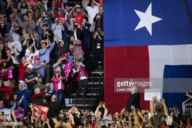 S President Donald Trump takes the stage for a rally in support of Sen Ted Cruz on October 22 2018 at the Toyota Center in Houston Texas Cruz the...
