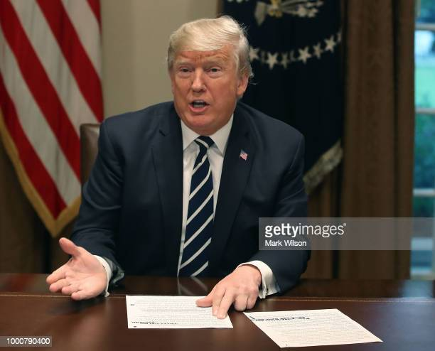 S President Donald Trump talks about his meeting with Russian President Vladimir Putin during a meeting with House Republicans in the Cabinet Room of...
