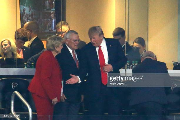 S President Donald Trump talks to Georgia Governor Nathan Deal and his wife Sandra Dunagan during the second quarter of the CFP National Championship...
