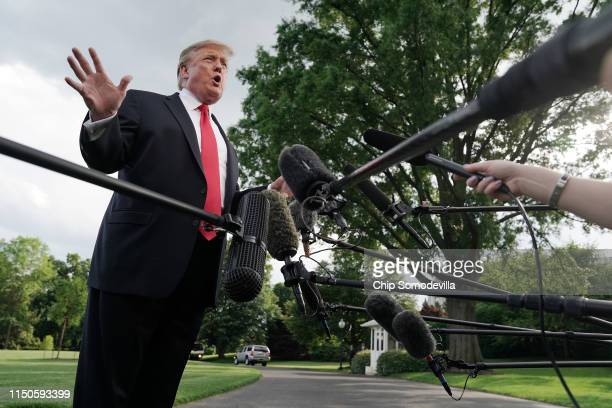S President Donald Trump talks to journalists as he departs the White House for a campaign rally in Pennsylvania May 20 2019 in Washington DC On his...