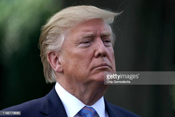 S President Donald Trump talks to journalists before boarding Marine One and departing the White House August 02 2019 in Washington DC Trump is...