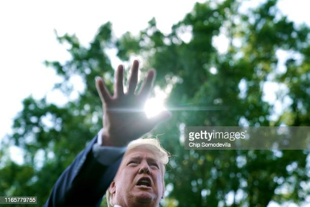 President Donald Trump talks to journalists before boarding Marine One and departing the White House August 02, 2019 in Washington, DC. Trump is...