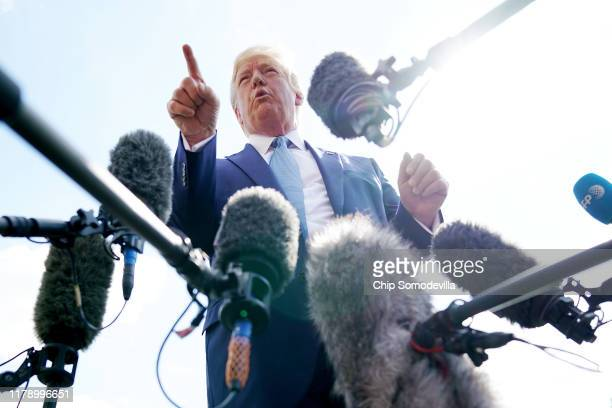S President Donald Trump talks to journalists on the South Lawn of the White House before boarding Marine One and traveling to Walter Reed National...