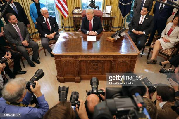 S President Donald Trump talks to journalists while hosting workers and members of his cabinet for a meeting in the Oval Office at the White House...
