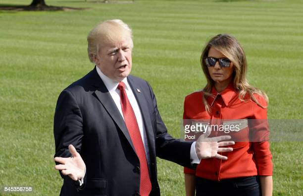 US President Donald Trump talks to members of the media about Hurricane Irma as first lady Melania Trump looks on upon arrival on the South Lawn of...