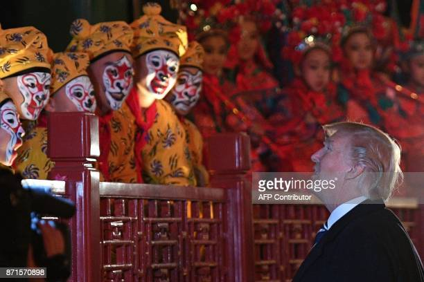 President Donald Trump talks to opera performers at the Forbidden City in Beijing on November 8 2017 US President Donald Trump toured the Forbidden...