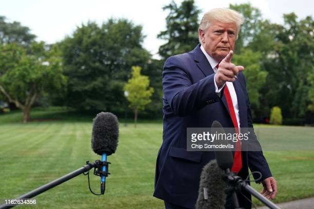 S President Donald Trump talks to reporters as he departs the White House for a campaign rally July 17 2019 in Washington DC Trump is traveling to...