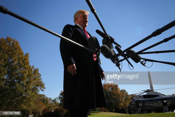US President Donald Trump talks to reporters before boarding Marine One on the South Lawn of the White House on November 4 2018 in Washington DC...