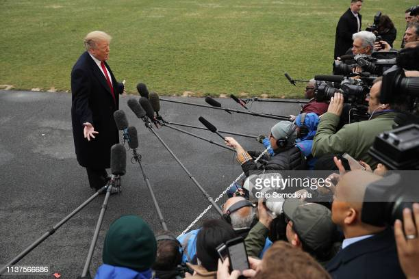 S President Donald Trump talks to reporters before departing the White House March 22 2019 in Washington DC Trump is traveling to his MaraLago home...
