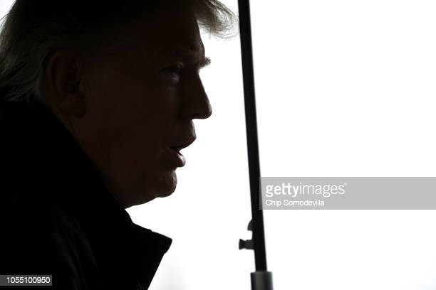S President Donald Trump talks to reporters before leaving the White House October 15 2018 in Washington DC The president and first lady Melania...
