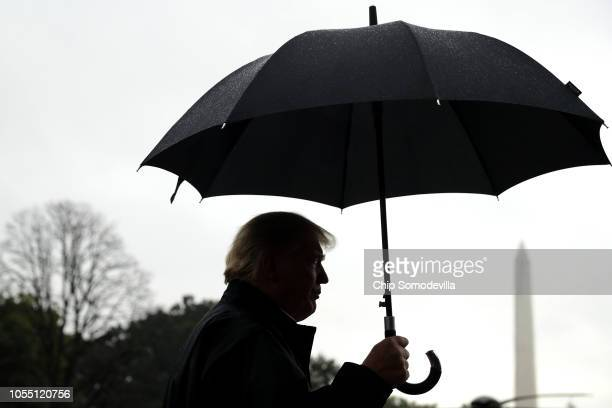 S President Donald Trump talks to reporters before leaving the White House October 15 2018 in Washington DC The president and and first lady Melania...