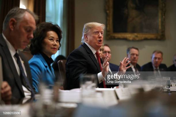 US President Donald Trump talks to reporters during a cabinet meeting with Interior Secretary Ryan Zinke Transportation Secretary Elaine Chao and...