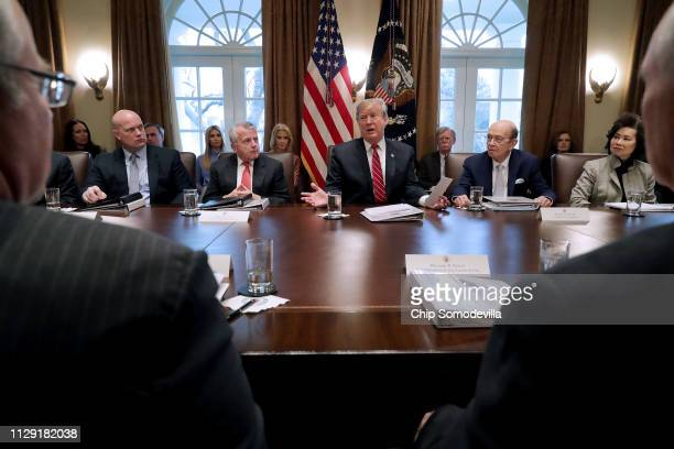 S President Donald Trump talks to reporters during a meeting with members of his cabinet including acting Attorney General Matthew Whitaker Deputy...