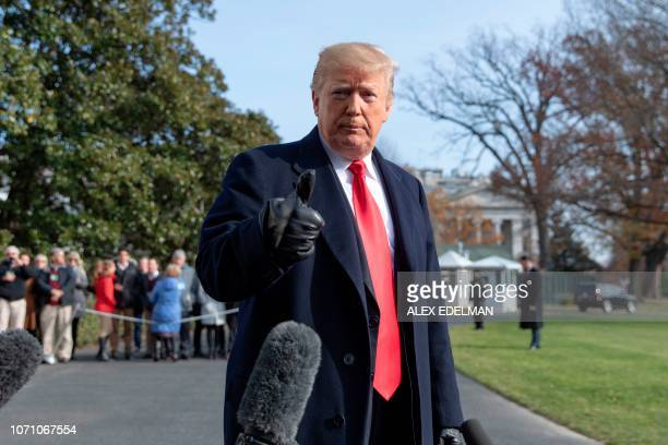 US President Donald Trump talks to reporters prior to boarding Marine One as he departs the White House in Washington DC on December 8 2018 US...
