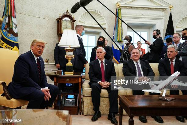 President Donald Trump talks to reporters while hosting Iraqi Prime Minister Mustafa Al-Kadhimi and Vice President Mike Pence, Secretary of State...