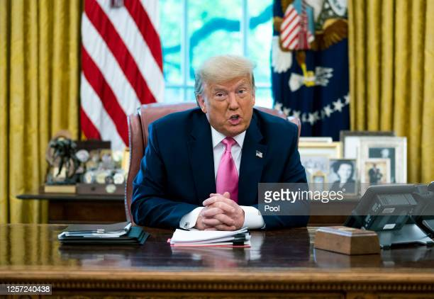 President Donald Trump talks to reporters while hosting Republican Congressional leaders and members of his cabinet in the Oval Office at the White...