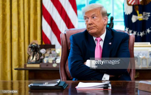 S President Donald Trump talks to reporters while hosting Republican Congressional leaders and members of his cabinet in the Oval Office at the White...