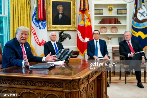 S President Donald Trump talks to reporters while hosting Vice President Mike Pence Treasury Secretary Steven Mnuchin White House Chief of Staff Mark...