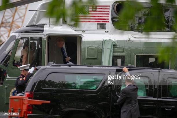 US President Donald Trump talks to the Marine pilots as he exits Marine One as he visits first lady Melania Trump at Walter Reed Medical Center on...