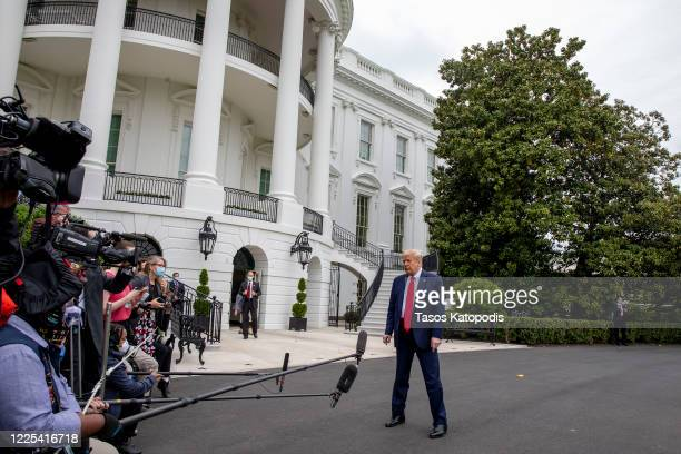 President Donald Trump talks to the media after landing on the south lawn of the White House on May 17, 2020 in Washington, DC. Asked by the media if...
