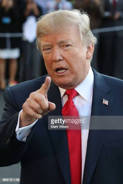 President Donald Trump talks to the media before he and first lady Melania Trump depart on Marine One on November 3 2017 in Washington DC President...