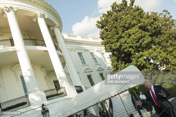 US President Donald Trump talks to the press as leaves the White House by the South lawn and boards Marine One en route to Wheeling West Virginia for...