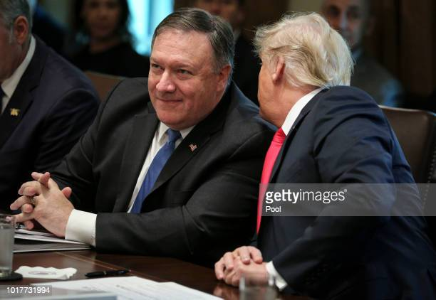 President Donald Trump talks to US Secretary of State Mike Pompeo during a cabinet meeting in the Cabinet Room of the White House on August 16 2018...