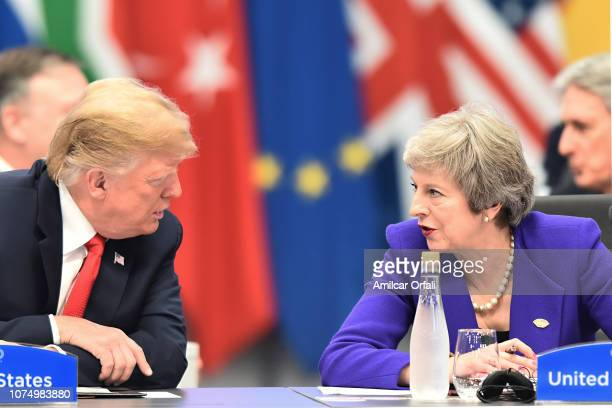 President Donald Trump talks with British Prime Minister Theresa May during the opening day of Argentina G20 Leaders' Summit 2018 at Costa Salguero...