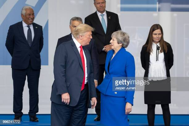 President Donald Trump talks with British Prime Minister Theresa May at the photo call at the 2018 NATO Summit at NATO headquarters on July 11 2018...