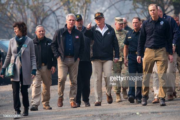 President Donald Trump talks with Congressman Kevin McCarthy as they tour the Skyway Villa Mobile Home and RV Park with Gov Jerry Brown during his...