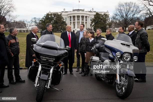 President Donald Trump talks with Harley Davidson executives on the South Lawn of the White House February 2 2017 in Washington DC President Trump is...