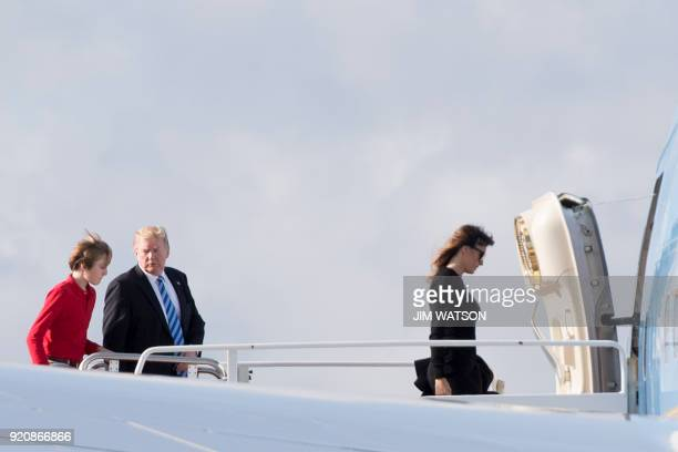 US President Donald Trump talks with his son Barron as First Lady Melania Trump boards Air Force One at Palm Beach International Airport in West Palm...