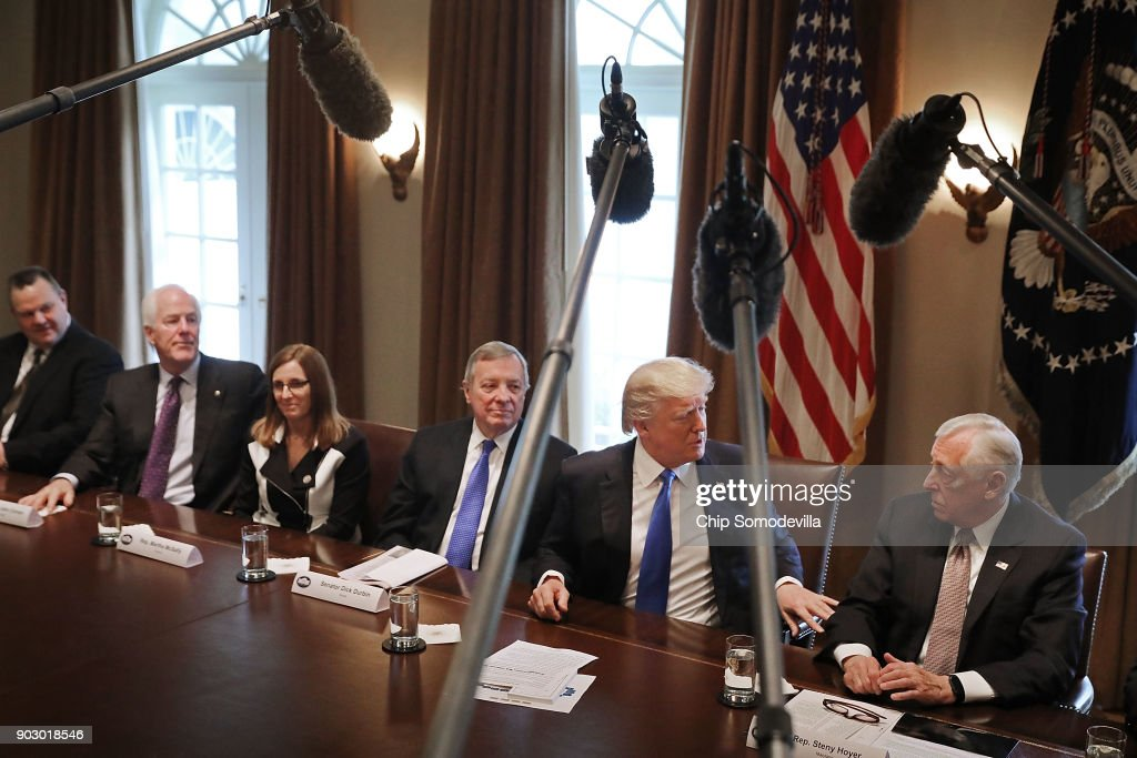 U.S. President Donald Trump (2nd R) talks with House Minority Whip Steny Hoyer (D-MD) (R) as he presides over a meeting about immigration with Republican and Democrat members of Congress, including (L-R) Sen. Jon Tester (D-MT), Senate Majority Whip John Cornyn (R-TX), Rep. Martha McSally (R-AZ) and Senate Minority Whip Richard Durbin (D-IL) in the Cabinet Room at the White House January 9, 2018 in Washington, DC. In addition to seeking bipartisan solutions to immigration reform, Trump advocated for the reintroduction of earmarks as a way to break the legislative stalemate in Congress.
