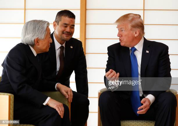 US President Donald Trump talks with Japan's Emperor Akihito during their meeting at the Imperial Palace in Tokyo on November 6 2017 President Donald...