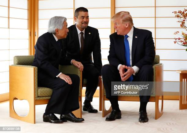 US President Donald Trump talks with Japan's Emperor Akihito during their meeting at the Imperial Palace in Tokyo on November 6 2017 Trump lashed out...