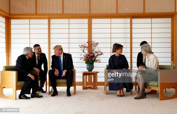 US President Donald Trump talks with Japan's Emperor Akihito while his wife Melania talks with Empress Michiko at the Imperial Palace in Tokyo on...