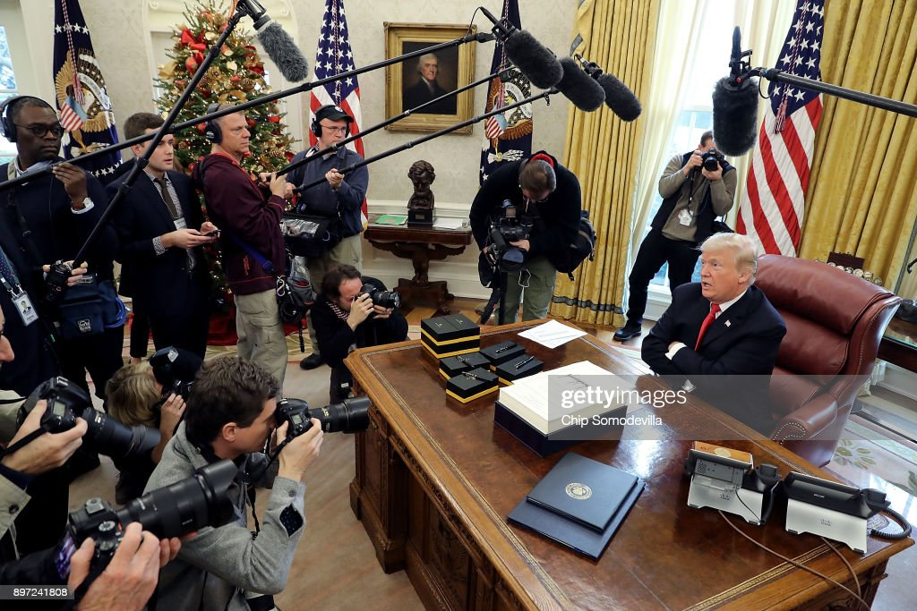U.S. President Donald Trump talks with journalists after signing tax reform legislation in the Oval Office December 22, 2017 in Washington, DC. Trump praised Republican leaders in Congress for all their work on the biggest tax overhaul in decades.