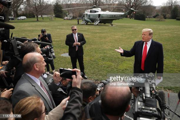 S President Donald Trump talks with journalists before departing the White House March 20 2019 in Washington DC Trump is traveling to Ohio where he...