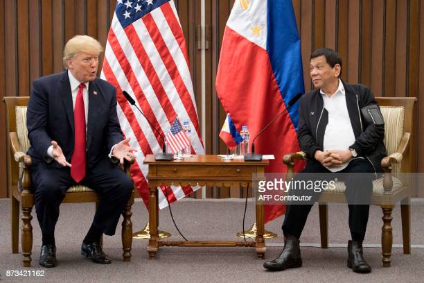 US President Donald Trump talks with Philippine President Rodrigo Duterte during their bilateral meetin on the side line of the 31st Association of...