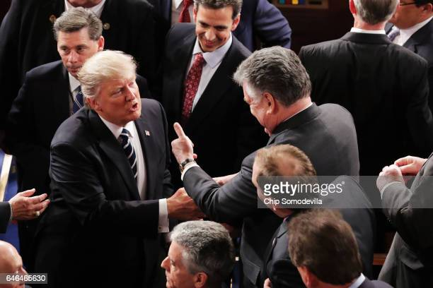 S President Donald Trump talks with Rep Peter King after addressing a joint session of the US Congress on February 28 2017 in the House chamber of...
