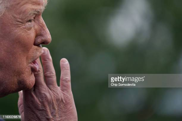 S President Donald Trump talks with reporters as he departs the White House July 19 2019 in Washington DC Trump is traveling to New Jersey to host a...