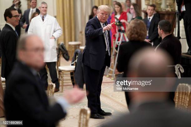 S President Donald Trump talks with small business owners while departing an event on supporting small businesses through the Paycheck Protection...