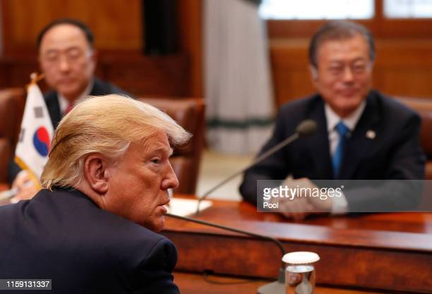 President Donald Trump talks with South Korean President Moon Jae-in during their meeting at the presidential Blue House on June 30, 2019 in Seoul,...