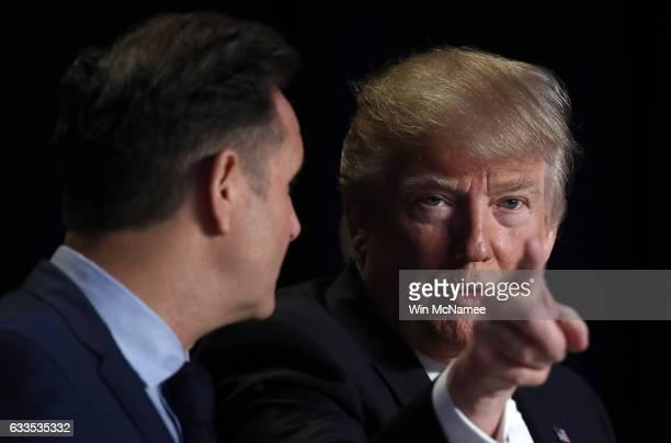 US President Donald Trump talks with television producer Mark Burnett at the National Prayer Breakfast February 2 2017 in Washington DC Every US...