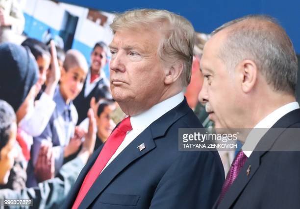 US President Donald Trump talks with Turkeys President Recep Tayyip Erdogan at NATO headquarters in Brussels during the NATO summit on July 11 2018