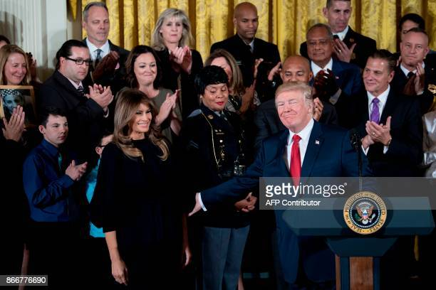 US President Donald Trump thanks First Lady Melania Trump before delivering remarks on combatting drug demand and the opioid crisis on October 26...