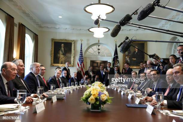 US President Donald Trump third left meets with Alexis Tsipras Greece's prime minister third right during a working lunch in the Cabinet Room of the...