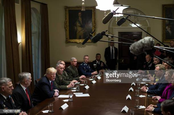 US President Donald Trump third left speaks as Jim Mattis US secretary of defense left and General Joseph Dunford chairman of the Joint Chiefs of...